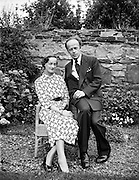Erskine Childers, minister for Posts and Telegraphs with fiance, Miss Rita Dudley.22/08/1952..Erskine Hamilton Childers (11/12/1905 - 17/11/1974) served as the fourth President of Ireland from 1973 until his death in 1974. He was a TD from 1938 until 1973. Childers served as Minister for Posts and Telegraphs (1951-1954, 1959-1961, and 1966-1969), Minister for Lands (1957-1959), Minister for Transport and Power (1959-1969), and Minister for Health (1969-1973). He was appointed Tánaiste in 1969..His father Robert Erskine Childers, a leading Irish Republican and author of the espionage thriller The Riddle of the Sands, was executed during the Irish Civil War...Childers married Ruth Ellen Dow in 1925. They had five children, Ruth Ellen Childers, born in July 1927, Erskine, born in March 1929, followed by Roderick Winthrop Childers in June 1931, and in November 1937 twin daughters, Carainn and Margaret Osgood Childers. ..After the death of Dow in 1950, Childers married again, in 1952, to Rita Dudley. Together they had a daughter, Nessa, who is currently a Labour Party MEP. Rita Dudley died on 9 May 2010...Apparently the couple's mixed marriage (Erskine Hamilton Childers was an Anglican, she a Roman Catholic) caused some controversy; the then Roman Catholic Archbishop of Dublin, John Charles McQuaid tried to discourage them from marrying. They eventually opted to marry in Paris.