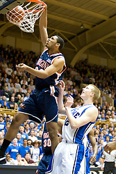 Virginia forward Mike Scott (32) dunks over Duke forward Kyle Singler (12).  The Duke Blue Devils hosted the Virginia Cavaliers in men's basketball at Cameron Indoor Stadium on the campus of Duke University in Durham, NC on January 13, 2008.