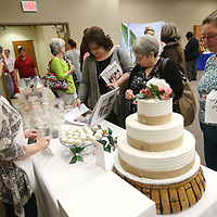 Lauren Wood | Buy at photos.djournal.com<br /> Attendees visit the Cakes by Rita vendor booth during the Mud and Magnolias Home and Garden Expo Saturday morning at the ICC Belden campus.