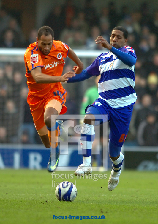 London - Saturday January 31st, 2009: Mikele Leigertwood of QPR in action against Jimmy Kebe of Reading during the Coca Cola Championship match at Loftus Road, London. (Pic by Focus Images)