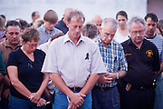 22 SEPTEMBER 2007 -- PHOENIX, AZ: People pray during a vigil for Phoenix Police Officer Nick Erfle, who was murdered Tuesday, Sept. 18, when he stopped a man for jaywalking on a Phoenix street. The man, Erik Martinez, was an illegal immigrant with a lengthy criminal history who had been deported from the United States and snuck back in. He was a member of a Mexican gang and wanted on felony assault warrants, which is why he shot Erfle when he was stopped for jaywalking. Martinez carjacked a passing vehicle in an effort to escape but was shot and killed a few miles from where he killed Erfle. Photo by Jack Kurtz / ZUMA Press