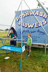 Image ©Licensed to i-Images Picture Agency. 05/07/2014. Oxford, United Kingdom. Cornbury Music Festival,The Great Tew Park, Chipping Norton.Oxfordshire.<br /> Picture Shows Festival goers getting clean whilst camping at Cornbury. Picture by  i-Images