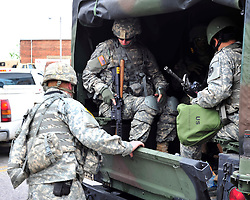 Law enforcement officers and soldiers from the Maryland National Guard on May 1, 2015, keep a watchful eye throughout Baltimore after days of unrest following Freddie Gray's fatal injury April 12  while in police custody.