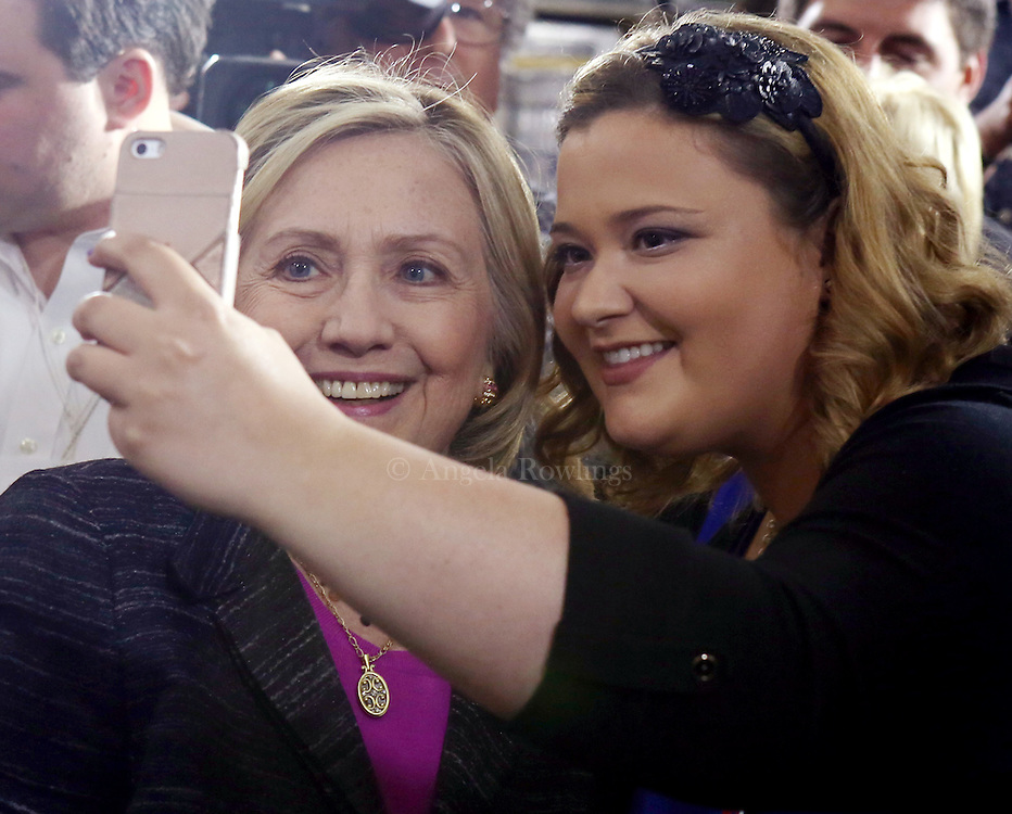 (Hampton, NH - 5/22/15) Former Secretary of State and presidential candidate Hillary Clinton poses for a selfie at Smuttynose Brewery, Friday, May 22, 2015. Staff photo by Angela Rowlings.