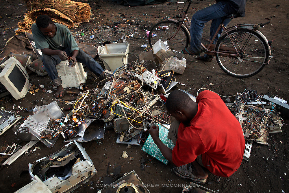 Computer monitors are broken apart to salvage metal and circuit boards, at Agbogbloshie dump, in Accra, Ghana.