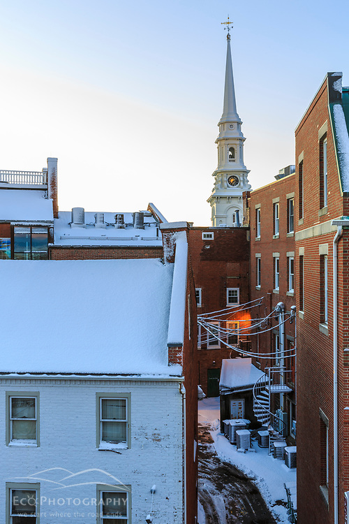 The North Church steeple rises above an alley in Portsmouth, New Hampshire. Winter.