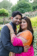 Lovely Indian couple enjoys a photography session in a public garden.