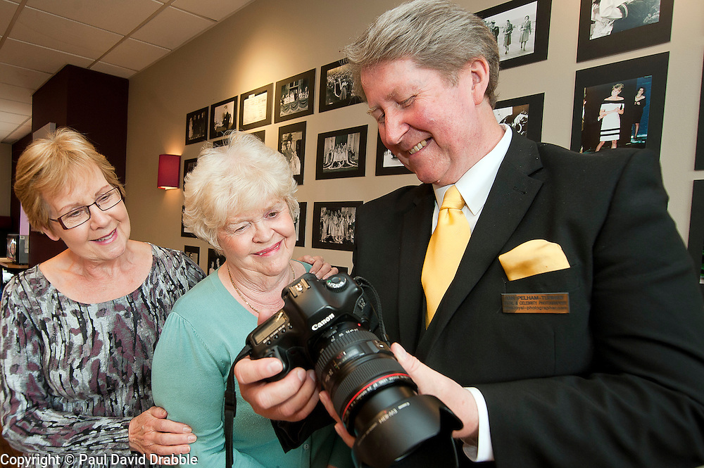 Left to right .Dorothy Wright and Beryl Wood with Royal Photographer Ian Pelham-Turner in the Debenhams restaurant Harrogate on Thursday evening..7 June 2012.Image © Paul David Drabble