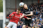 Josh Brownhill (8) of Bristol City and Eunan O'Kane (14) of Leeds United challenge for a header during the EFL Sky Bet Championship match between Bristol City and Leeds United at Ashton Gate, Bristol, England on 21 October 2017. Photo by Graham Hunt.
