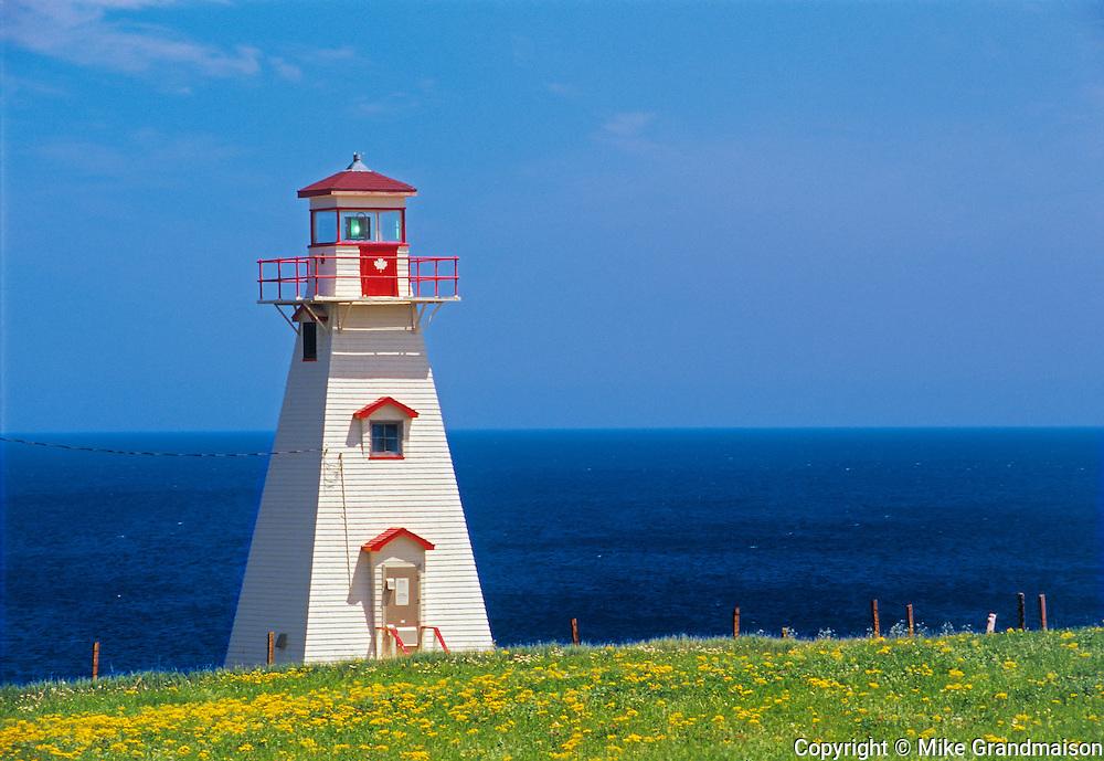 Lighthouse by the Atlantic Ocean