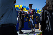 Peter Rafe poses with Principal Cheryl Lawton after receiving his diploma during the graduation ceremony at Milpitas High School in Milpitas, California, on June 6, 2015. (Stan Olszewski/SOSKIphoto)