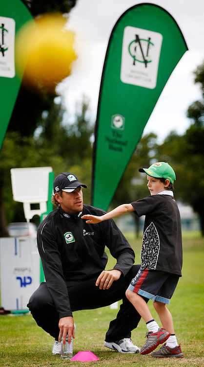 Jacob Oram coaches Ryan Pithey (8) during the intermediate throwing practice during the National Bank Super Camp, a National Bank initiative to connect with cricket's grass roots. Held at the East Shirley Cricket Club, Christchurch, New Zealand. Thursday, 27 January 2011. Joseph Johnson / PHOTOSPORT.