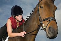 Female horseback holding bridle