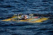 Submersible JAGO at the Lophelia sulareef in Norway. Trondheimfjord, North Atlantic Ocean, Norway | <br /> Pilot Jürgen Schauer beim Abtauchen im Tauchboot JAGO. Er führt noch eine letzte Sichtkontrolle durch, bevor er für 3 Stunden in der Dunkelheit verschwindet. Er wird gemeinsam mit einem Wissenschaftler Proben vom Sulariff in 250 Meter Tiefe nehmen. Trondheimfjord, Norwegen