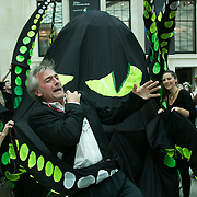 Bp-or-not-BP stage a splash mob art intervention at the British Museum in protest against the continued BP sponsorship of the exhibition 'Sunken Cities' 25th of September 2016. An actor pretending to be a BP security officer is eaten by the kraken. A flock of merfolk and BP pirates roamed the museum as well as a kraken, a giant sea monster.