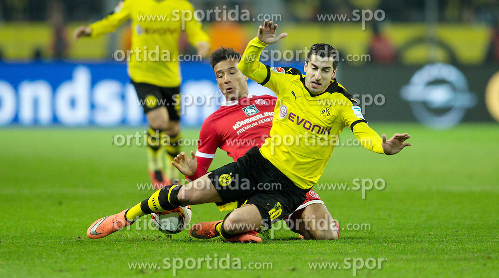 13.03.2016, Signal Iduna Park, Dortmund, GER, 1. FBL, Borussia Dortmund vs 1. FSV Mainz 05, 26. Runde, im Bild Karim Onisiwo (FSV Mainz 05 #21) im Zweikampf gegen Henrikh &quot;Micki&quot; Mkhihtaryan (Borussia Dortmund #10) // during the German Bundesliga 26th round match between Borussia Dortmund and 1. FSV Mainz 05 at the Signal Iduna Park in Dortmund, Germany on 2016/03/13. EXPA Pictures &copy; 2016, PhotoCredit: EXPA/ Eibner-Pressefoto/ Schueler<br /> <br /> *****ATTENTION - OUT of GER*****