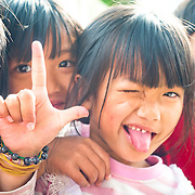 In the mountains of Taiwan cheerful Bunun Aboriginal tribe children eagerly  pose for the camera on a sunny day in Namasiya Township, Kaoshiung County, Taiwan