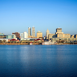 Picture of Peoria skyline with downtown city buildings along the Illinois River waterfront and the Spirit of Peoria riverboat.