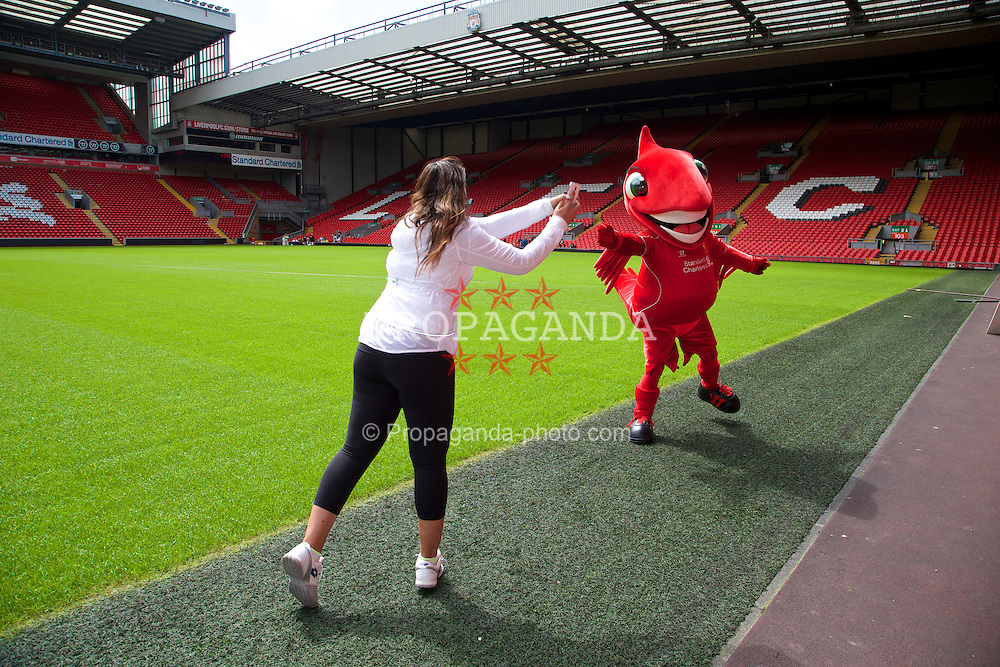LIVERPOOL, ENGLAND - Saturday, June 21, 2014: Wimbledon champion Marion Bartoli pretends to play tennis with Liverpool FC mascot Mighty Red on a visit to Anfield during Day Three of the Liverpool Hope University International Tennis Tournament. (Pic by David Rawcliffe/Propaganda)