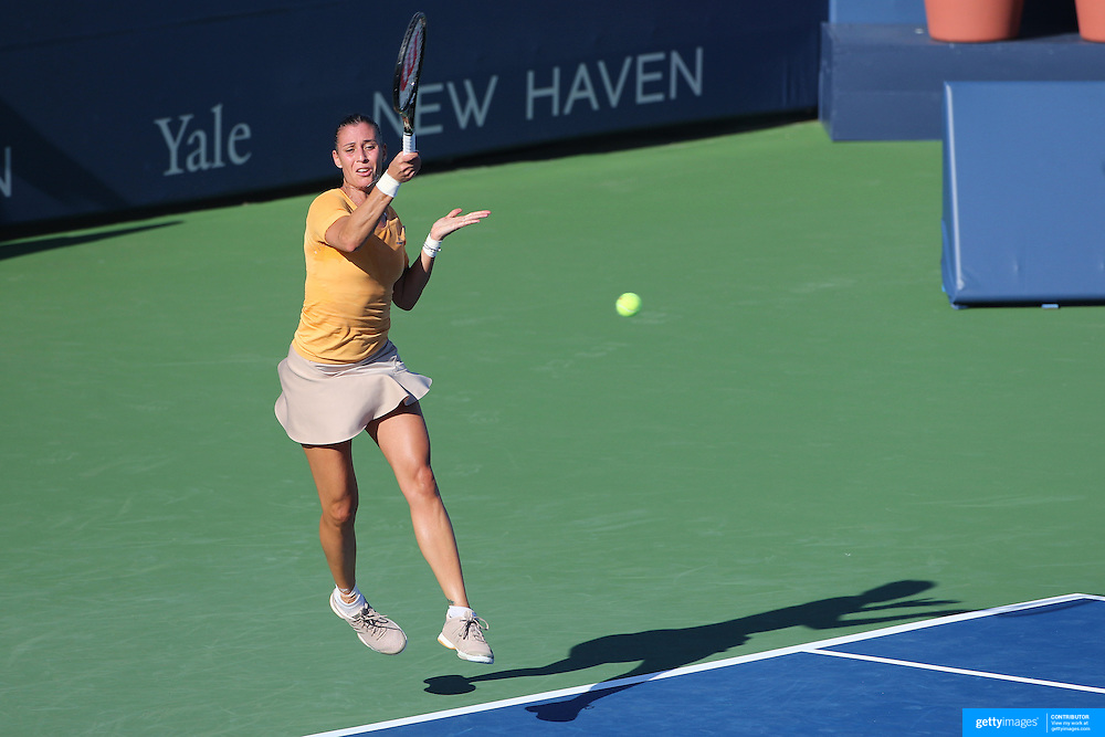 Flavia Pennetta, Italy, in action during the first round of the Connecticut Open at the Connecticut Tennis Center at Yale, New Haven, Connecticut, USA. 17th August 2014. Photo Tim Clayton
