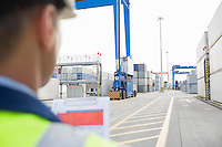 Male supervisor with clipboard in shipping yard