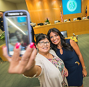 Diana Dávila, right, poses for a selfie with ollowing swearing in ceremonies for newly elected Houston ISD trustees, January 14, 2016.