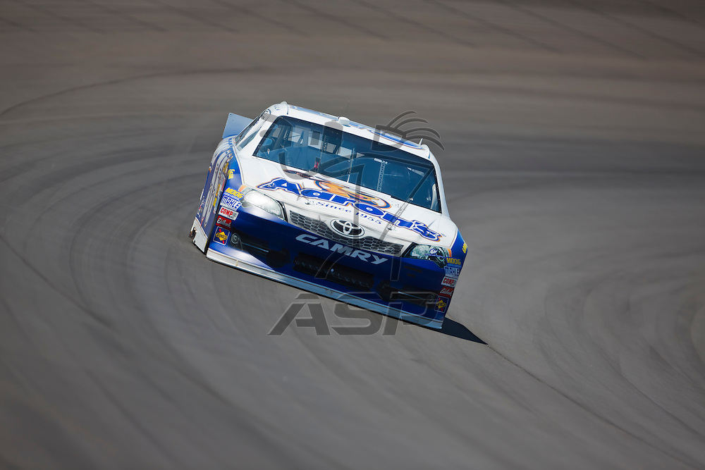 BROOKLYN, MI - JUN 14, 2012:  Mark Martin (55) brings his car through the turns during the second test session for the Quicken Loans 400 at the Michigan International Speedway in Brooklyn, MI.
