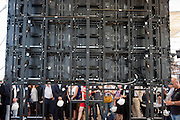 View of the back of the giant screen with guests and journalist gathered to see the official remarks of U.S. Secretary of State, John Kerry, simulcast from Washington D.C. at Groundbreaking Ceremony of USA Pavilion Expo Milano 2015, Rho-Pero, (Milan), July 16, 2014. &copy; Carlo Cerchioli<br /> <br /> Vista del retro dello schermo gigante, con ospiti e giornalisti riuniti per vedere l'intervento del Segretario di Stato americano, John Kerry, in collegamento diretto da Washington D.C. per la cerimonia di posa della prima pietra del padiglione USA di Expo Milano 2015, Rho-Pero, (Milano), 16 Luglio 2014.