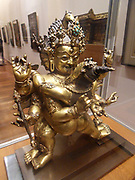 Hayagriva in union (yab-yum) with his wife of wisdom (prajna). Late 15th-early 16th century Tibetan sculpture. copper, encrusted, gilded, turquoise. Buddhist