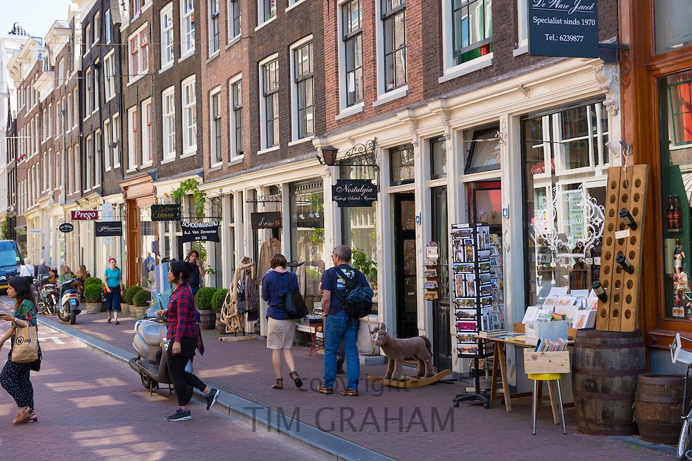 Tourists shopping along Herenstraat in the Nine Streets - De Negen Straatjes - 9 Streetss district of Jordaan, Amsterdam