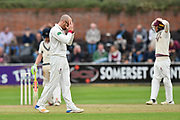 Jack Leach of Somerset has his head in his hands after Tom Abell of Somerset drops a catch during the Specsavers County Champ Div 1 match between Somerset County Cricket Club and Middlesex County Cricket Club at the Cooper Associates County Ground, Taunton, United Kingdom on 27 September 2017. Photo by Graham Hunt.