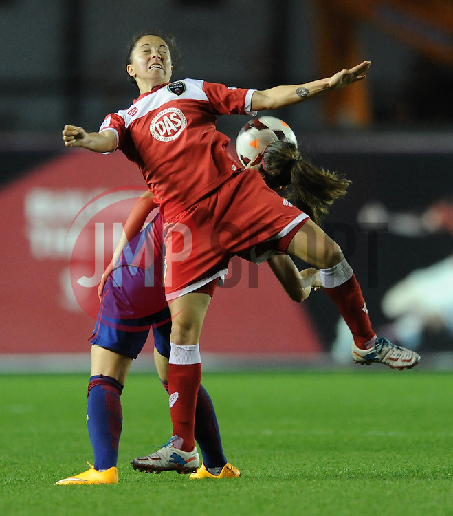 Bristol Academy Womens' Laura Del Rio Garcia challenges for the ball with FC Barcelona's Alexia Putellas - Photo mandatory by-line: Dougie Allward/JMP - Mobile: 07966 386802 - 13/11/2014 - SPORT - Football - Bristol - Ashton Gate - Bristol Academy Womens FC v FC Barcelona - Women's Champions League