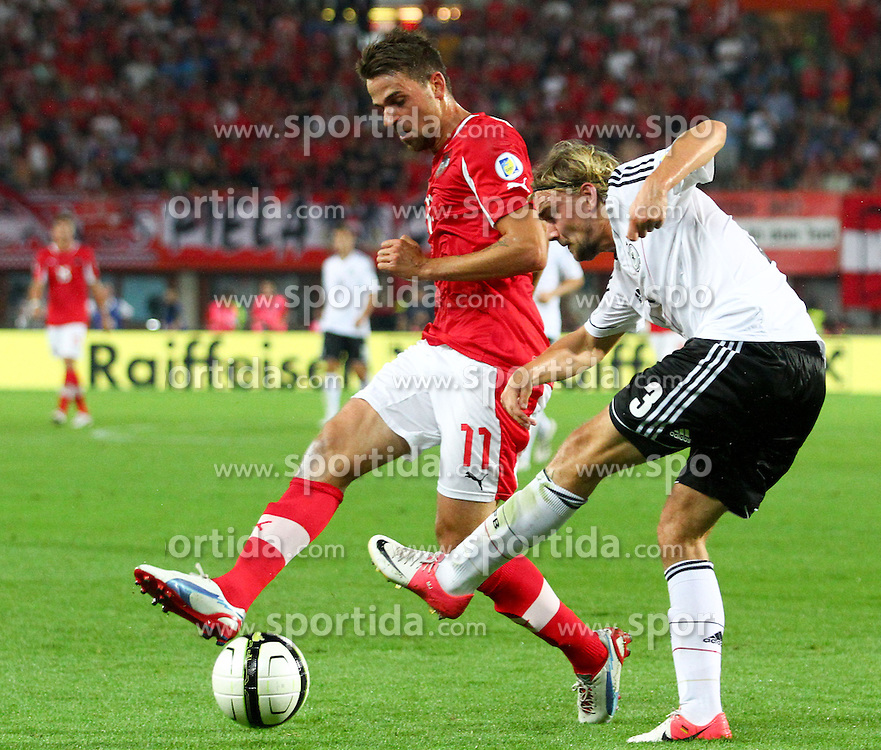 11.09.2012, Ernst Happel Stadion, Wien, AUT, FIFA WM Qualifikation, Oesterreich vs Deutschland, im Bild Martin Harnik, (AUT, #11) und Marcel Schmelzer, (GER, #3)  // during the FIFA World Cup Qualifier Match between Austria (AUT) and Germany (GER) at the Ernst Happel Stadion, Vienna, Austria on 2012/09/11. EXPA Pictures © 2012, PhotoCredit: EXPA/ Thomas Haumer