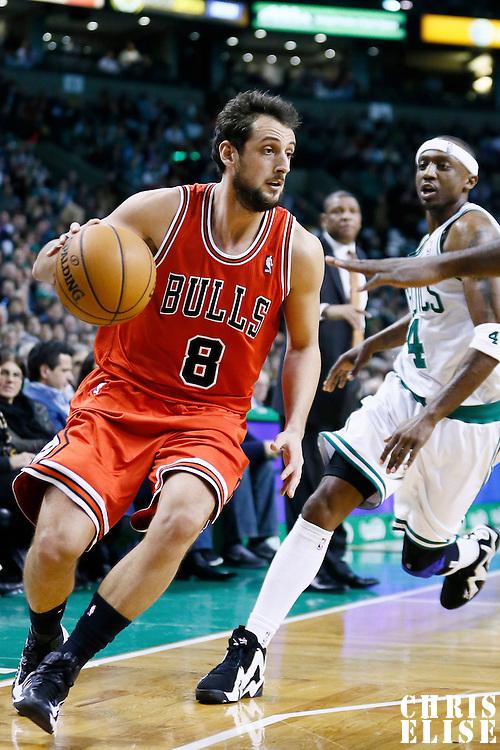 13 February 2013: Chicago Bulls shooting guard Marco Belinelli (8) drives past Boston Celtics shooting guard Jason Terry (4) during the Boston Celtics 71-69 victory over the Chicago Bulls at the TD Garden, Boston, Massachusetts, USA.