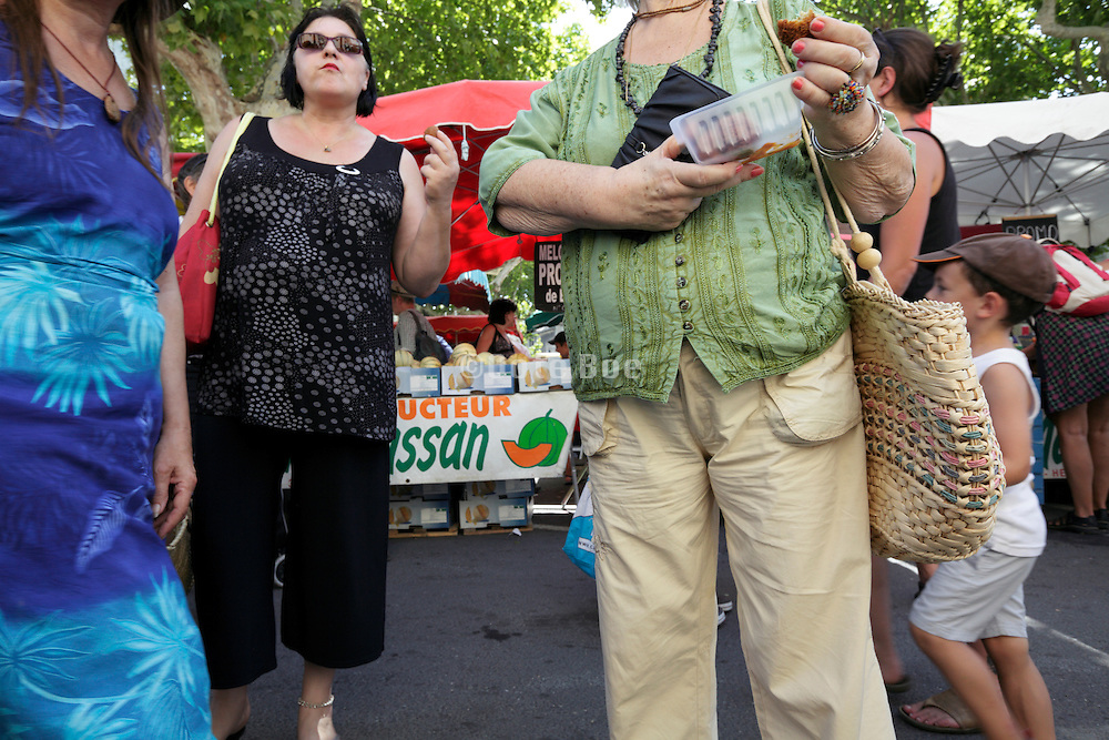 crowd of people at an outdoors regional farmers market