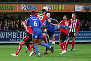 Lincoln City defender Callum Connolly (20) clearing the ball during the EFL Sky Bet League 1 match between AFC Wimbledon and Lincoln City at the Cherry Red Records Stadium, Kingston, England on 2 November 2019.