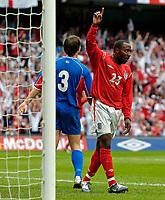 Fotball<br /> Foto: Jed Wee, Digitalsport<br /> NORWAY ONLY<br /> England v Island<br /> <br /> England v Iceland, Manchester Tournament, 05/06/2004.<br /> England's Darius Vassell sheepishly celebrates a lucky goal.