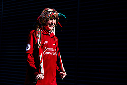 LIVERPOOL, ENGLAND - Saturday, March 23, 2019: A female supporter with a hat full of pin badges outside Anfield before the LFC Foundation charity match between Liverpool FC Legends and Milan Glorie at Anfield. (Pic by Paul Greenwood/Propaganda)