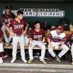 Jun 25, 2013; Omaha, NE, USA; Mississippi State Bulldogs players prepare in the dugout before game 2 of the College World Series finals against the UCLA Bruins at TD Ameritrade Park. Mandatory Credit: Derick E. Hingle-USA TODAY Sports