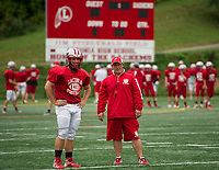 Tyler Richter and Coach Craig Kozens prepare for practice Thursday afternoon with  the Laconia Sachems.  (Karen Bobotas/for the Laconia Daily Sun)