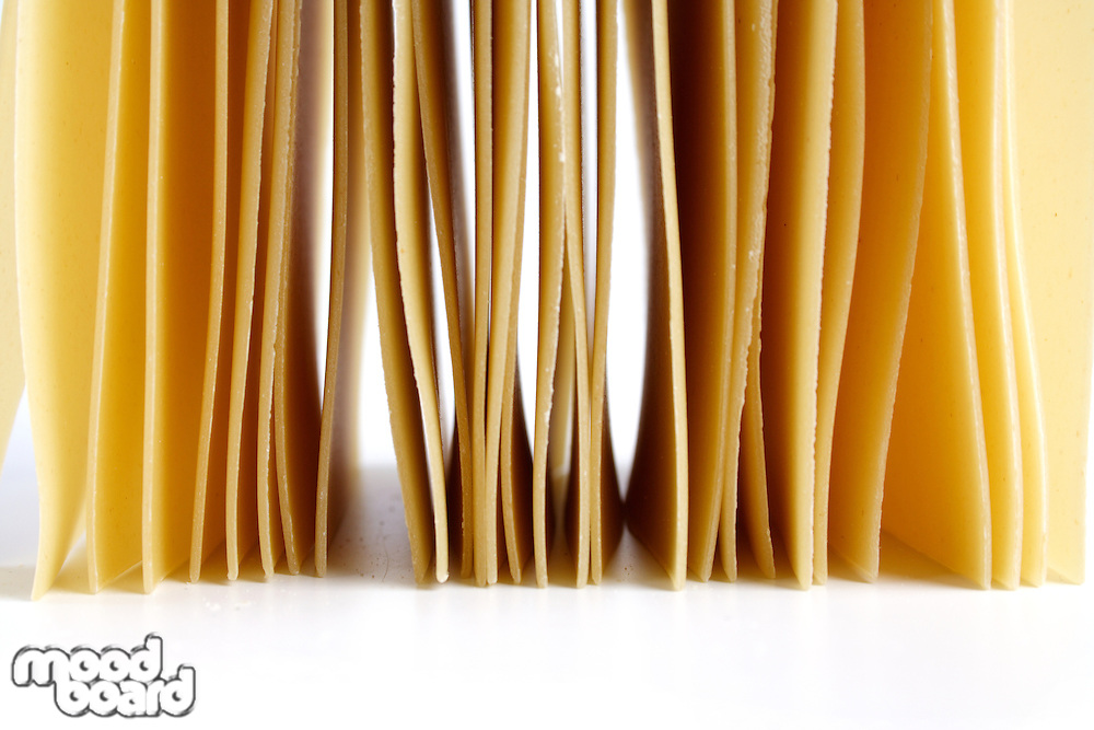 Lasagne raw pasta on white background
