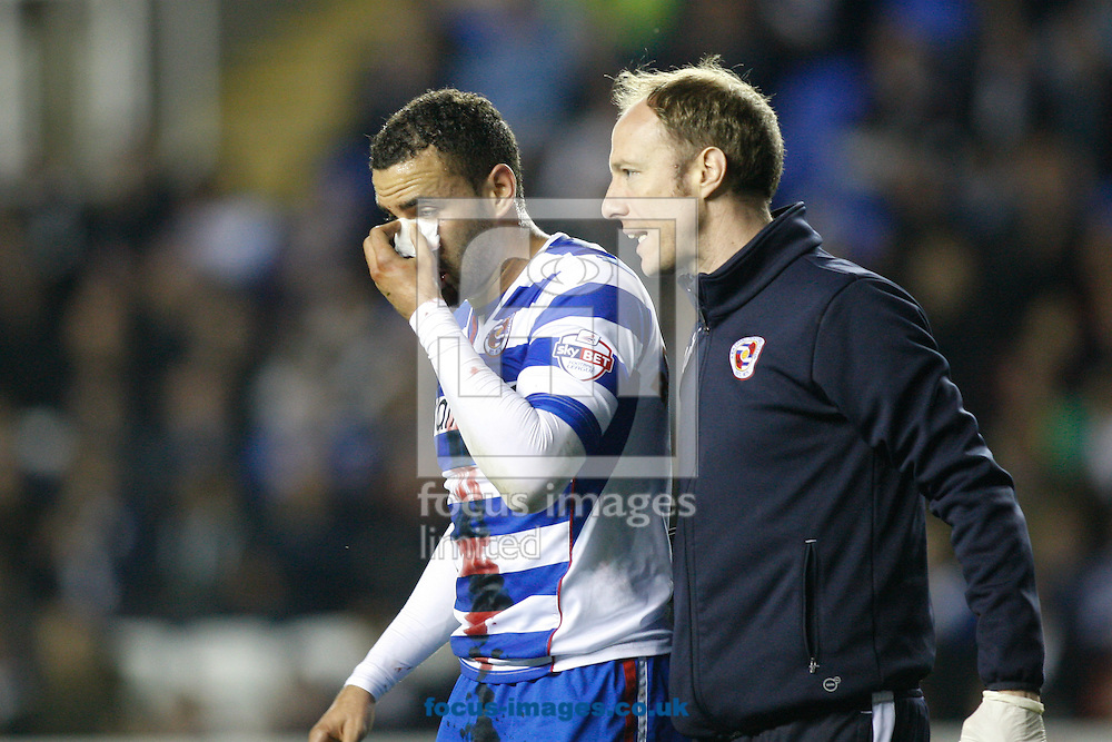Hal Robson-Kanu of Reading leaves the pitch with an injured nose during the Sky Bet Championship match at the Madejski Stadium, Reading<br /> Picture by Andrew Tobin/Focus Images Ltd +44 7710 761829<br /> 22/04/2014