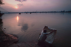 CALCUTTA, INDIA - The Hooghly River in Calcutta, India is an intricate part of daily life for city dwellers. It serves as a source for food, transportation, a bathroom and a place to do the family laundry. It is also a source of much disease. (Photo © Jock Fistick)