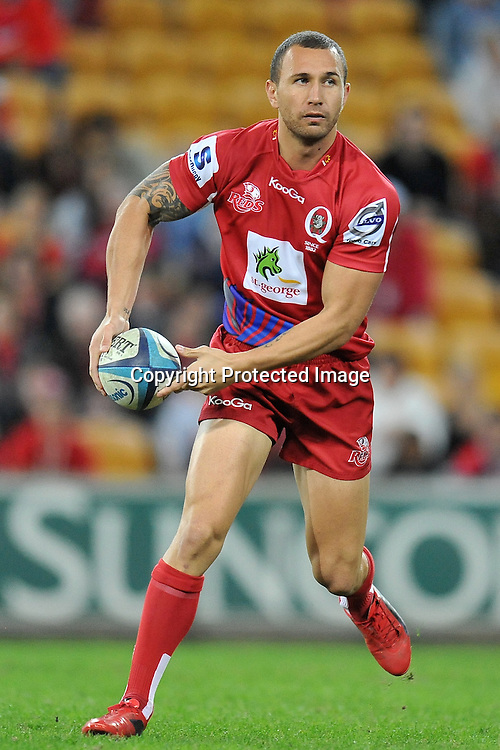 Quade Cooper passes to support out wide for the Reds during action from Super 15 rugby (Round 16) - Reds v Brumbies played at Suncorp Stadium, Brisbane, Australia on Saturday 4th May 2011 ~ Photo : Steven Hight (AURA Images) / Photosport
