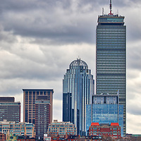 Boston skyline photography featuring the iconic Prudential Center in Back Bay along the Charles River. Partly cloudy skies were in the weather forecast and I was a bit hesitant to explore, but boy am I glad I went. The sailing boats added a color punch while the overcast sky showed beautiful grey tones in different cloud formations. <br />