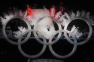 A snowboarder jumps through the Olympic Rings as part of the opening ceremonies of the 2010 Winter Games in Vancouver Friday night.
