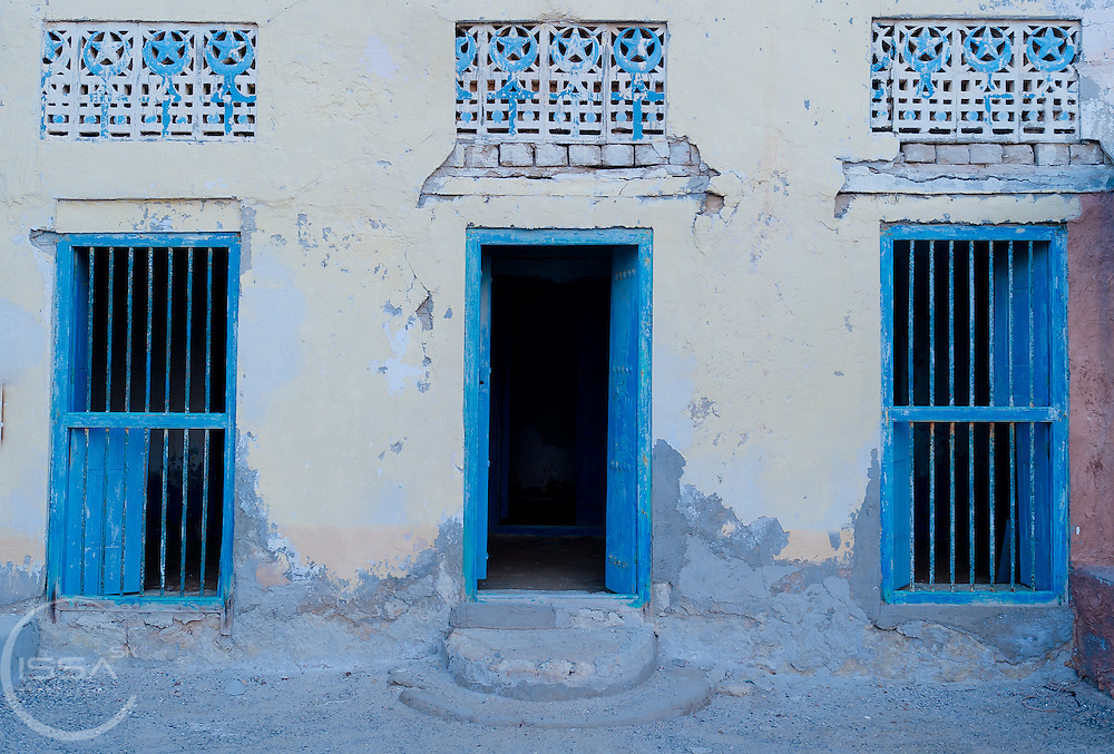 Blue door two blue windows