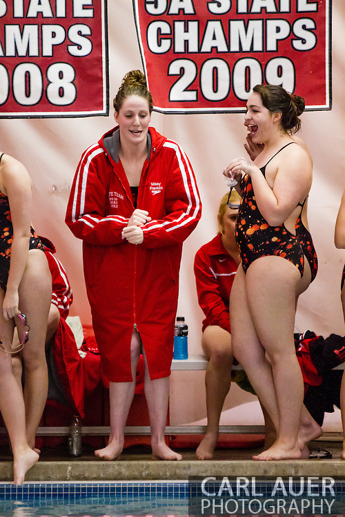 January 8, 2013: Olympic Gold Medalist and Regis Jesuit High School senior Missy Franklin clowns around with a teammate during the swim meet against Highlands Ranch at Regis Jesuit High School.  This was Franklin's return to the high school pool after swimming at the London Olympics.