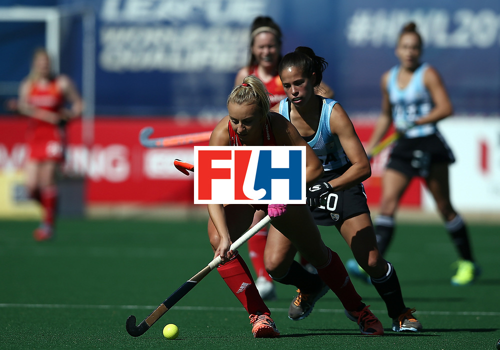 JOHANNESBURG, SOUTH AFRICA - JULY 23:  Hannah Martin of England controls the ball from Lucina von der Heyde of Argentina during day 9 of the FIH Hockey World League Women's Semi Finals 3rd/ 4t place match between England and Argentina at Wits University on July 23, 2017 in Johannesburg, South Africa.  (Photo by Jan Kruger/Getty Images for FIH)