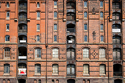 View of historic red brick warehouses at Speicherstadt beside canals in Hamburg Germany